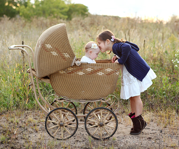 Little girls wtih baby buggy