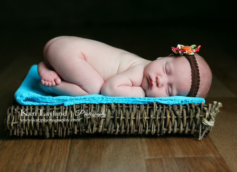 Newborn girl sleeping on stomach