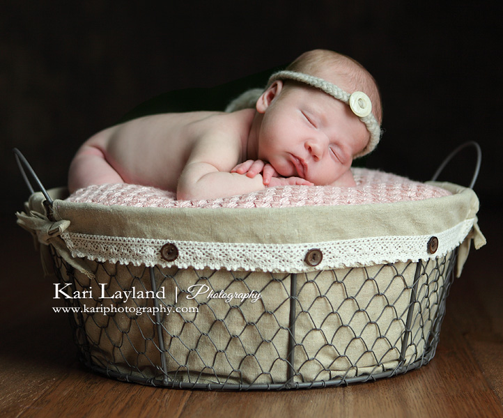 Baby sleeping in button basket
