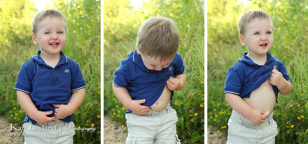 Portrait of a little boy looking at his belly button.  Mini sessions in Eagan MN.