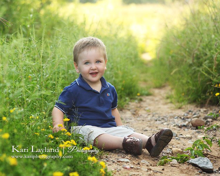 Sitting in the dirt.  Children's portraiture by Kari Layland, photographer.