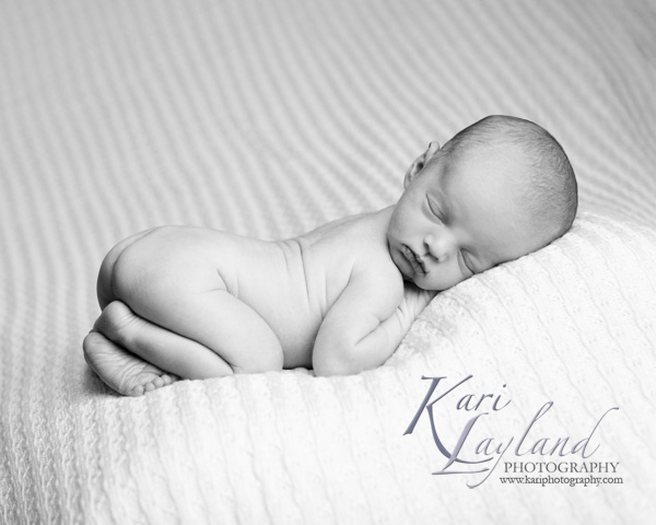 Baby boy sleeping on a soft blanket.  Photography by Kari Layland