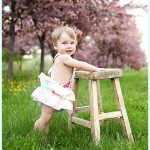 Baby girl standing portrait outdoors MN